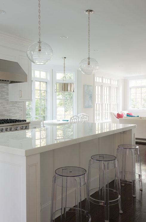 Ghost Barstools - Transitional - kitchen - Laura Tutun Interiors on white granite kitchen, white kitchen counter material, white kitchen counter bar,