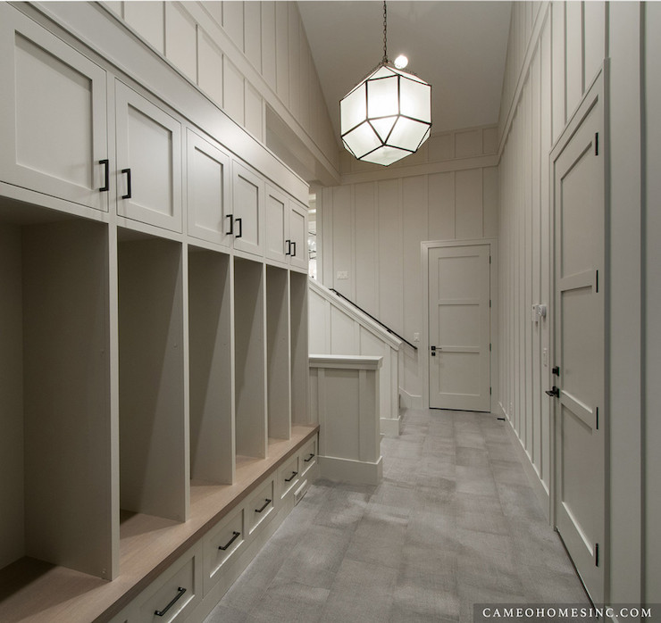 Monochromatic mud room with gray board and