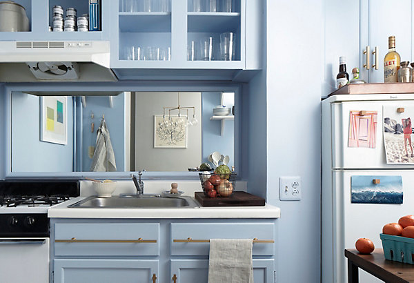 Blue Kitchen With Walls And Cabinetry Painted In Benjamin Moore Ice Pairing Brushed Brass Hardware White Countertops A Mirrored