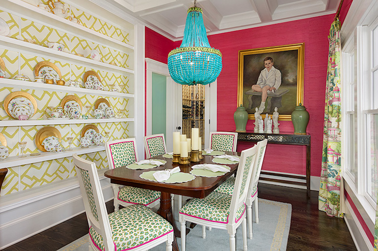 Formal Dining Room With Coffered Ceiling Over Hot Pink Grasscloth Wallpaper Framing Portrait In Gold Leaf Frame Slim Black Console Table Topped