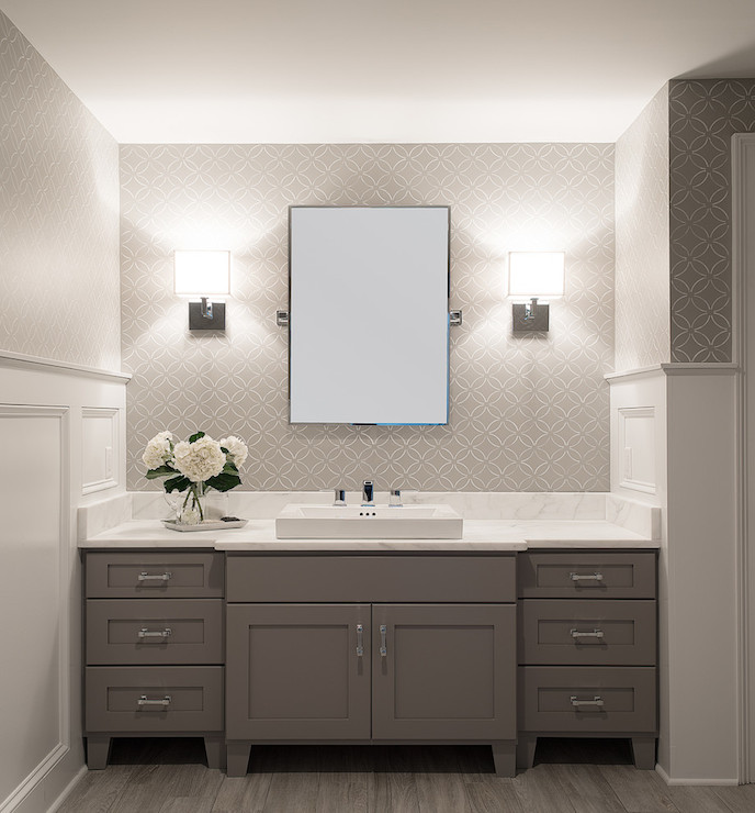 grey bathroom features white and grey wallpaper on top part of walls
