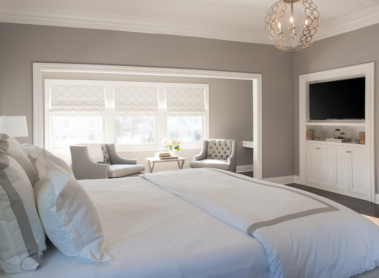 bedroom sitting nook features gorgeous gray walls and gray tufted