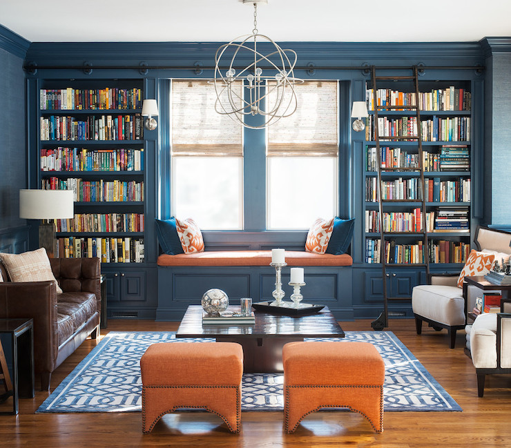 blue and orange den features blue grasscloth wallpaper on top part of ...