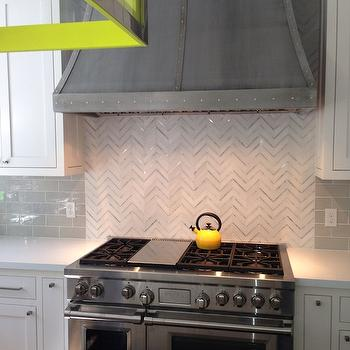 paired with white quartz countertops and gray subway tile backsplash