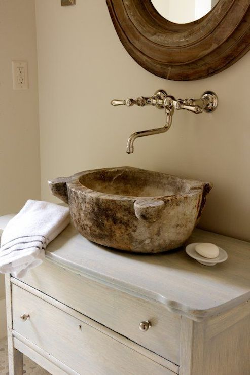 Exquisite Bathroom Features Oval Wood Mirror Paired With Wall Mounted  Bridge Faucet Over Rustic Vessel Sink On Re Purposed Gray Washed Vanity On  Pebble ...