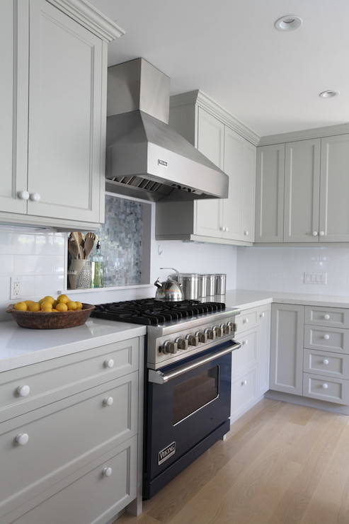Grey kitchen features grey cabinets painted Benjamin Moore Brushed