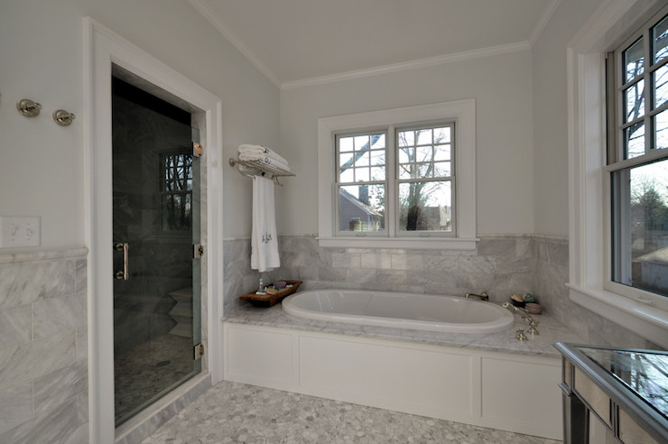 Oval bathtub transitional bathroom anthony james for Bathroom half wall tile