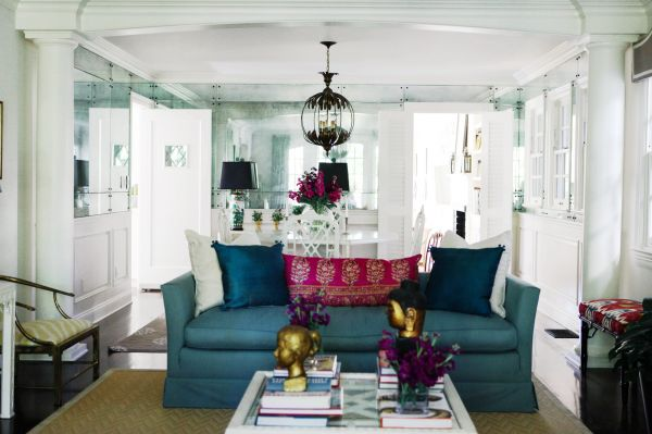 Striking living room with blue sofa layered with peacock blue silk pillows   white pillows and a fucshia pink paisley pillow in front of a white glass  topped  Blue Paisley Living Room Chairs Design Ideas. Paisley Couch Living Room Furniture. Home Design Ideas