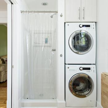Stacked washer and dryer design ideas for Washer and dryer in bathroom designs
