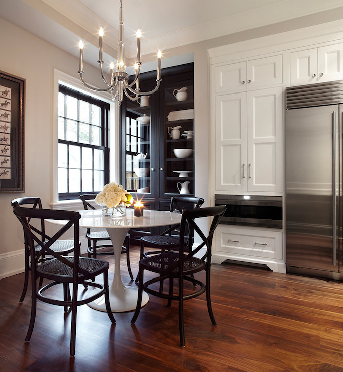 Kitchen Breakfast Area With White Cabinets Framing A Stainless Steel Refrigerator And Warming Drawer Beside Black Glass Front Built In China Cabinet