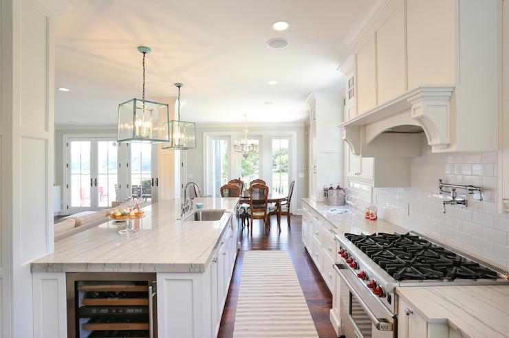Kitchen island wine fridge contemporary kitchen for Open galley kitchen with island
