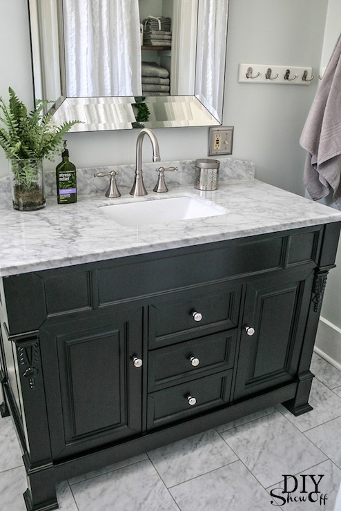 Beautiful Bathroom Features Pale Gray Walls Framing Pottery Barn Bevel  Mirror Over Black Vanity, Virtu USA Huntshire 48 In.