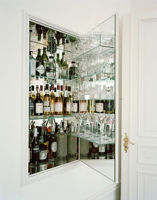 Hidden liquor cabinet eclectic dining room for Built in drinks cabinet