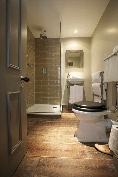 Corner shower ideas transitional bathroom the for Hardwood floor in bathroom
