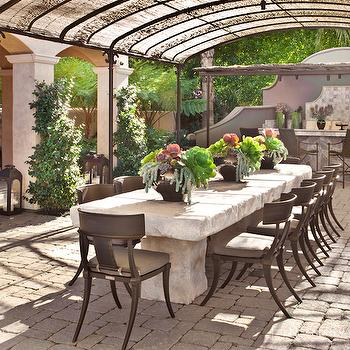 Pergola Over Zinc Top Dining Table And Gray Woven Dining