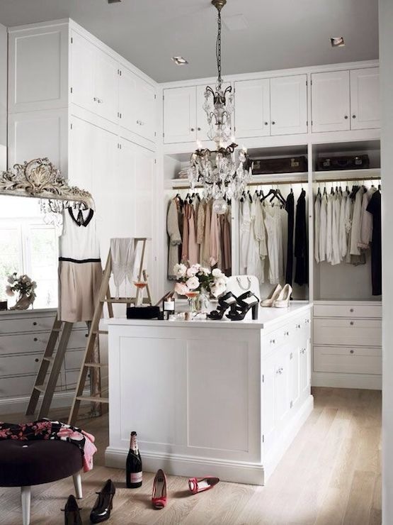 Chic Walk In Closet Features Small Crystal Chandelier Over Closet Island  Surrounded By Floor To Ceiling Built In Cabinets Accented With Ladders And  Round ...