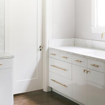 white cabinets brass pulls