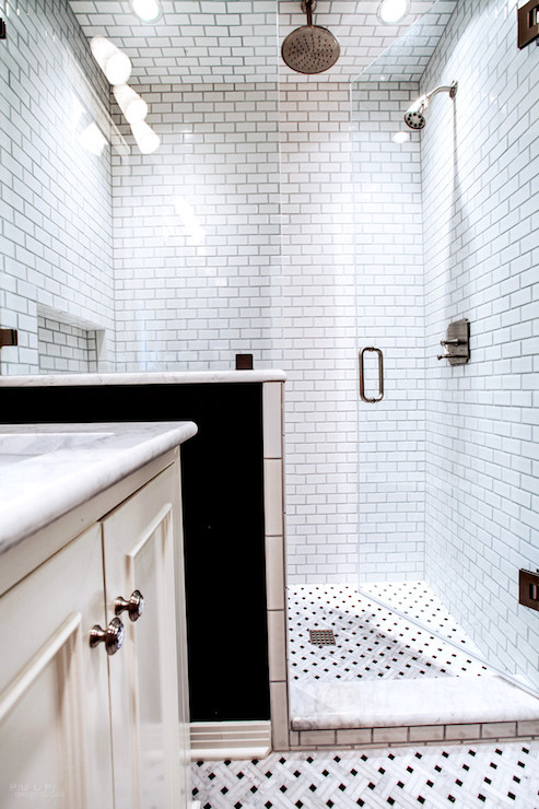 pictures of tiled walk in showers. Stunning bathroom features walk in shower accented with mini subway tile  surround rain head tiled niche and black white floor Subway Tile Shower Design Ideas