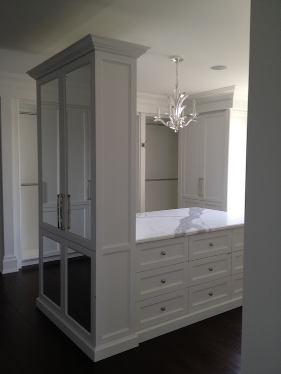Light gray closet island with white metallic cowhide rug for Walk in closet with island