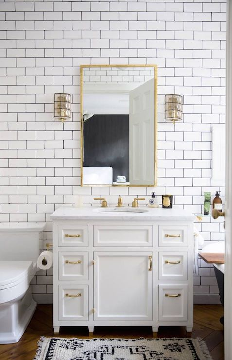White vanity brass pulls eclectic bathroom domino - White subway tile with black grout bathroom ...