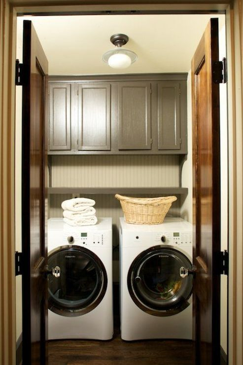 Cabinets over washer dryer transitional laundry room for Shelf above washer and dryer
