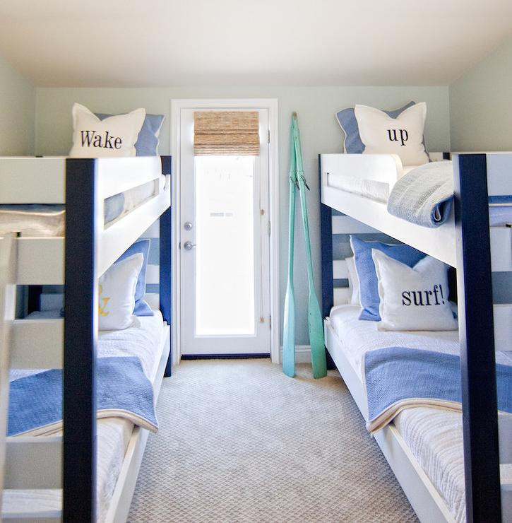 Beach cottage boys' room features white and blue bunk beds dressed in ...