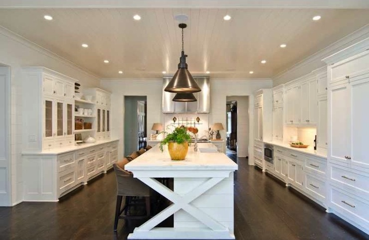 Beautiful Kitchen With Paneled Ceiling Dotted With Pot Lights And  Industrial Light Pendants Suspended Over White Kitchen Island With X Trim,  White Marble ...