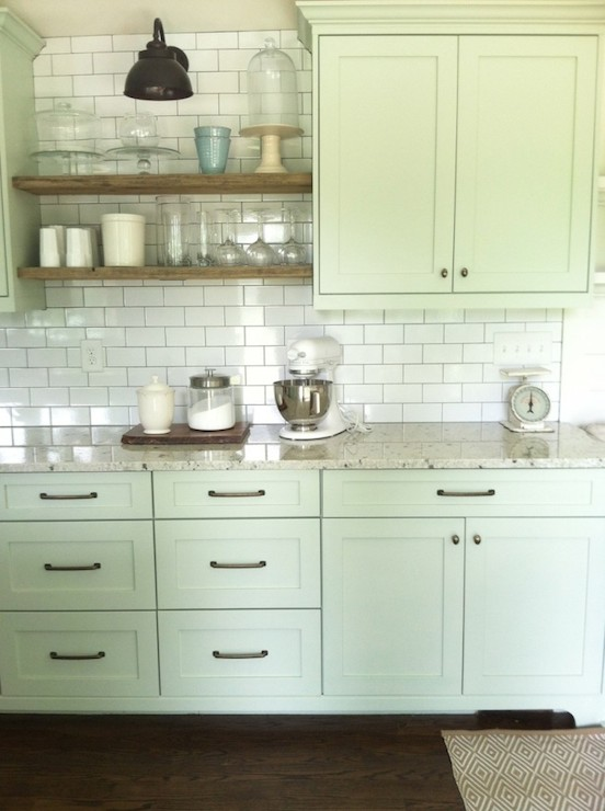 Beautiful Kitchen With Pale Green Shaker Cabinetry Painted Benjamin Moore  Tea Light Accented With Aged Brass Hardware And Granite Countertops Below A  Subway ...