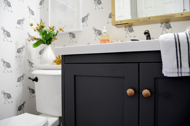 Fantastic Bathroom Features Beware The Moon Ostrich Wallpaper Framing Art  Over Toilet Topped With White Oval Tray Filled With White Ribbed Vase And  Dwell ...