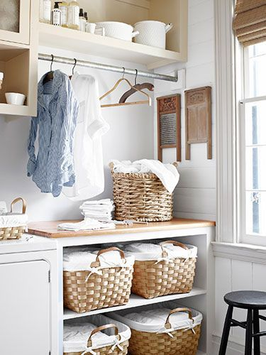 laundry room sorters country laundry room country living. Black Bedroom Furniture Sets. Home Design Ideas