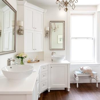 white bathroom features curved cabinets topped with his and her bowl