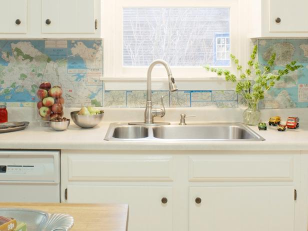 ... With Oil Rubbed Bronze Hardware Alongside White Counters Which Frame A Stainless  Steel Dual Basin Sink With Gooseneck Faucet Framed By A Map Backsplash.