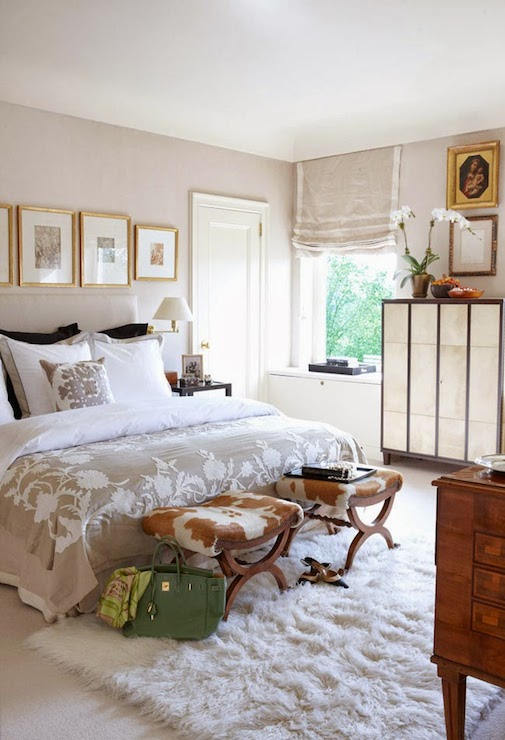 Cowhide stools transitional bedroom veranda - Over the bed art ...