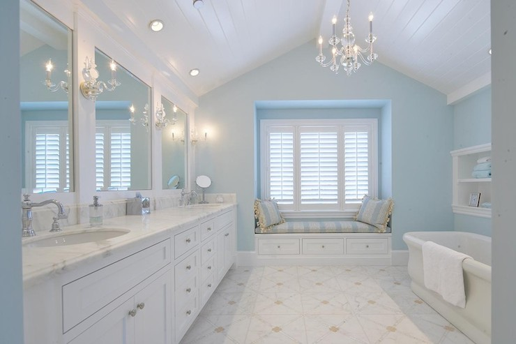 stunning bathroom with glass chandelier hung from the beadboard