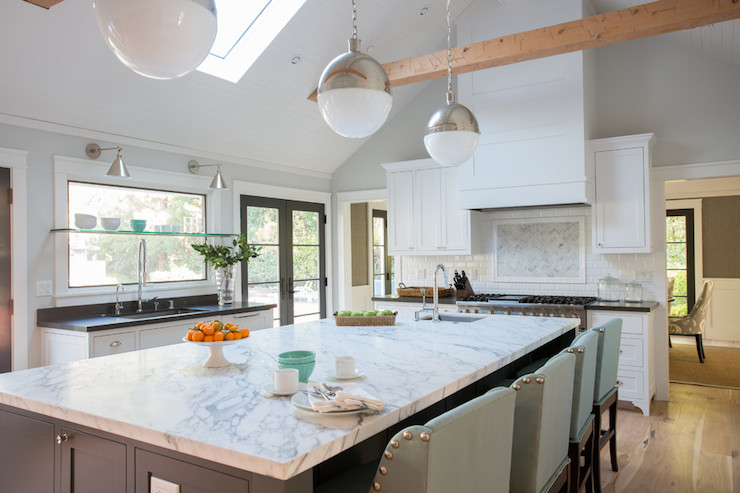 Amazing Kitchen With Vaulted Ceiling Accented With Skylight And Visual  Comfort Lighting Hicks Pendants In Polished Nickel Illuminating Gray Island  Topped ...