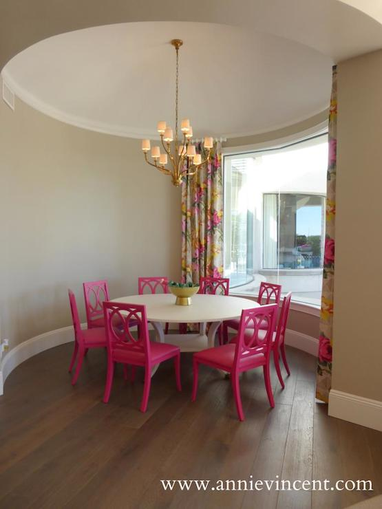 gray dining room with pink velvet dining chairs - transitional