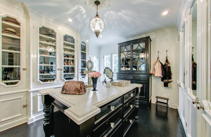 Magnificent Closet Features Vintage Pendant Light Illuminating Black Closet  Island Accented Black Turned Legs And Glass Knobs Topped With White Marble  ...
