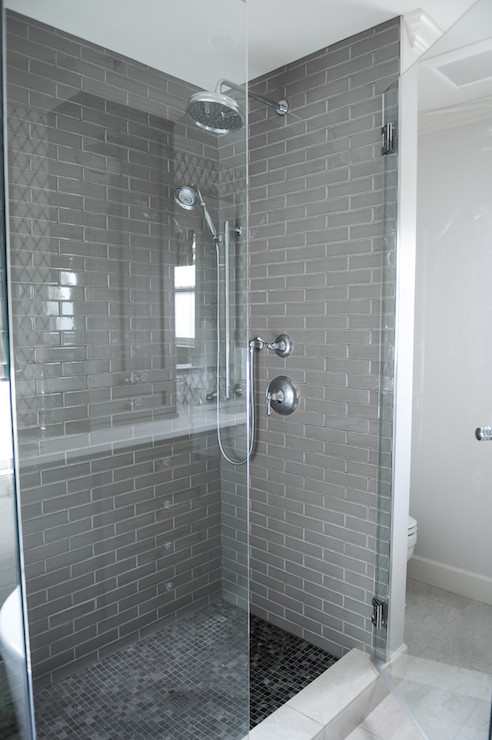 Beautiful Gray And White Bathroom With Seamless Glass Shower Partition Framing A Gray  Tiled Interior With Rainfall Shower Head And Adjustable Shower Head Over A  Black ... Good Looking