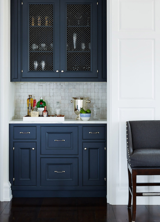 navy upper cabinets accented with chicken wire doors over navy