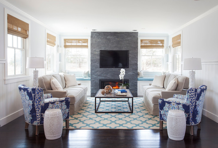 Elegant Living Room Features Built In Window Seats Dressed Turquoise Cushions Flanking Floor To Ceiling Gray Stone Fireplace Accented With Flatscreen TV