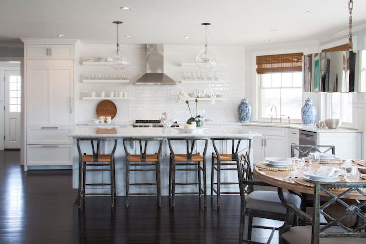 Beautiful Gorgeous Kitchen With Clear Glass Globe Pendants Illuminate White Marble  Topped Island Lined With Grey Wishbone Barstools Situated Across From  Stacked White ...