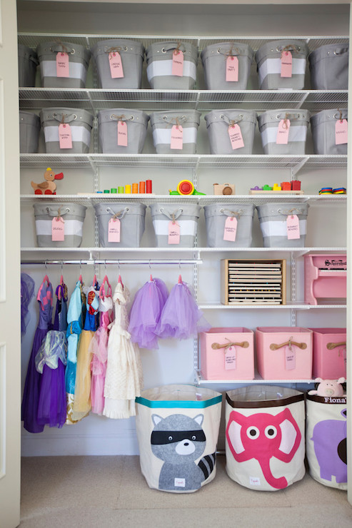 Delightful Little Girlu0027s Closet Features Stacked Shelving Filled With White And Gray  Striped Bins, Pottery Barn Kids Rugby Canvas Storage Totes, Over Low  Clothes Rod ...