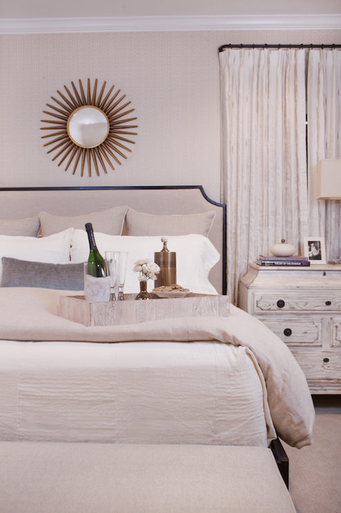 View Full Size Monochromatic Bedroom Features Gold Sunburst Mirror On Light Beige