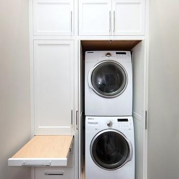 pull out laundry room cabinet with ironing board transitional laundry room. Black Bedroom Furniture Sets. Home Design Ideas