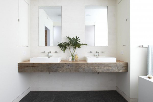 Incredible bathroom with inset mirrors over reclaimed wood floating vanity  topped with rectangular vessel sinks paired with wall-mounted faucets. - Reclaimed Wood Bathroom Vanity Design Ideas