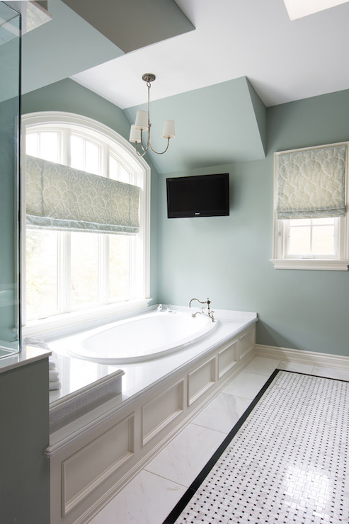 Incredible Bathroom With Oval Drop In Bathtub Accented With Wainscoting  Paneled With Hook Spout Faucet Below Arched Window Dressed With Blue Damask  Roman ...