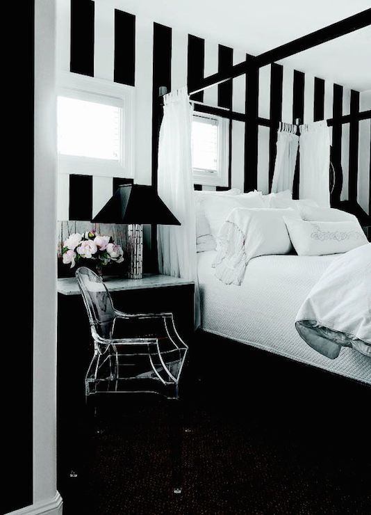 Black and white vertical striped walls frame off-set windows over ...