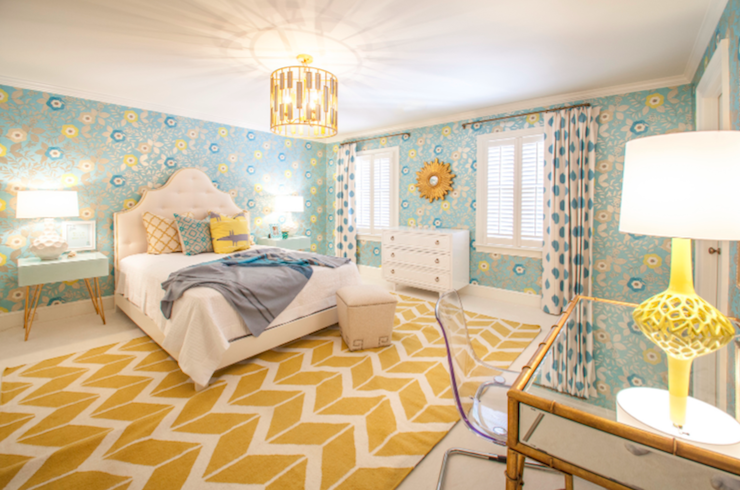 fun yellow and blue girlu0027s bedroom with blue and yellow floral wallpaper framing an arched tufted ivory headboard layered with blue and yellow