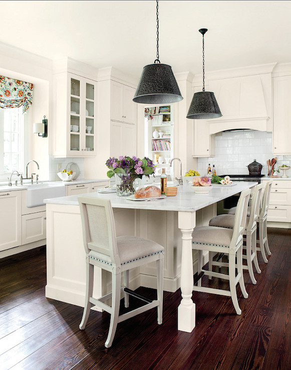 Chic Cottage Kitchen Features Black Light Pendants Illuminating Cream Island Accented With Turned Legs Topped Alabama White Marble Framing Sink