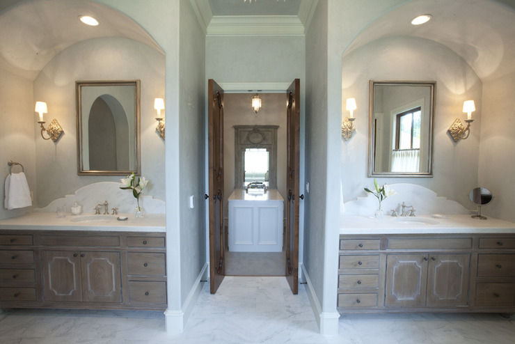 Stunning Bathroom With Arched Vanity Alcoves Framing Weathered Oak Vanities  With White Marble Countertops And Arched Marble Backsplash Below Silver  Leafed ...